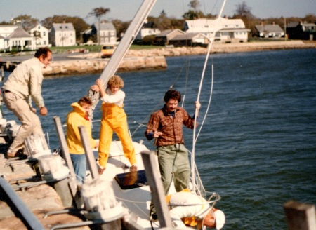 My brother Barry and Peter taking down the mast